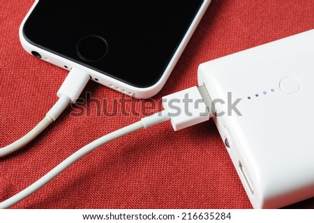 white power bank for charging mobile devices - stock photo