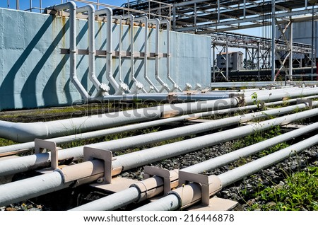 White power plant ground pipes  - stock photo