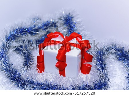 White presents with red ribbons, isolated on white background.
