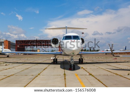 white private jets on the platform airport in the sun in summer - stock photo