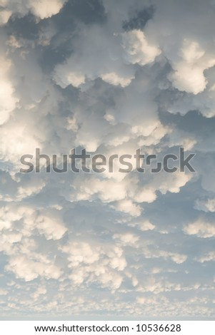 White puffy clouds in the sky - stock photo