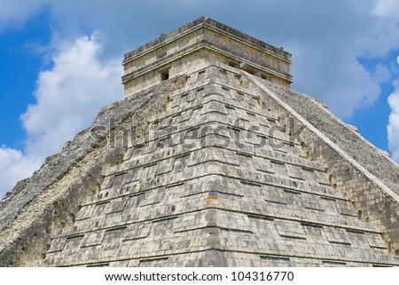 White puffy clouds over the Mayan Pyramid of Kukulkan (also known as El Castillo) and ruins at Chichen Itza, Yucatan Peninsula, Mexico - stock photo