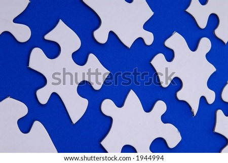 white puzzle on a blue background