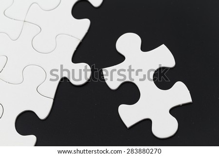 White puzzle on black background