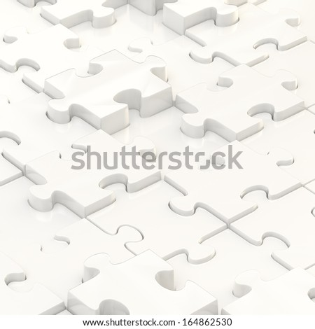 White puzzle pieces covered surface as an abstract background composition - stock photo