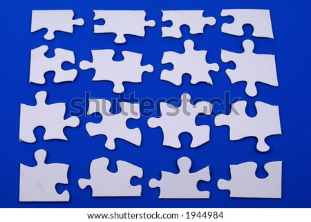 white puzzle pieces on blue