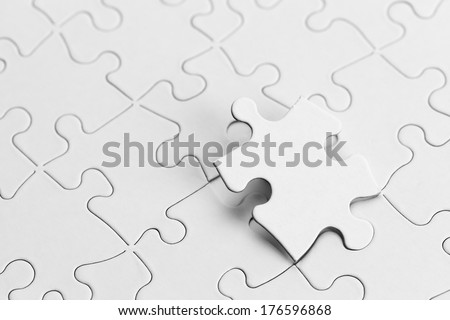 White Puzzle with Copy Space and Puzzle Piece. - stock photo