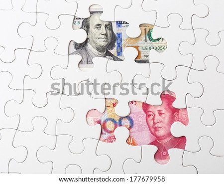 White puzzle with US and chinese banknote - stock photo