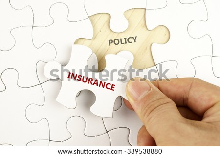 White puzzle with word INSURANCE and POLICY. - stock photo