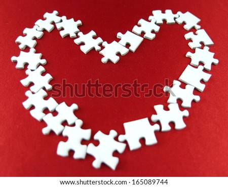 white puzzles forming a heart, symbol of love