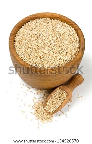 white quinoa in a wooden bowl isolated on white - stock photo