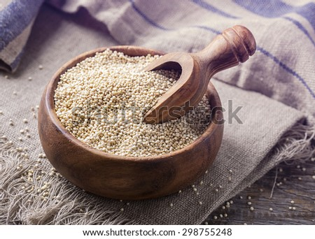 White quinoa seeds on a wooden background - stock photo
