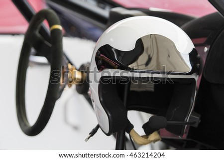 white racing helmet in a sports car