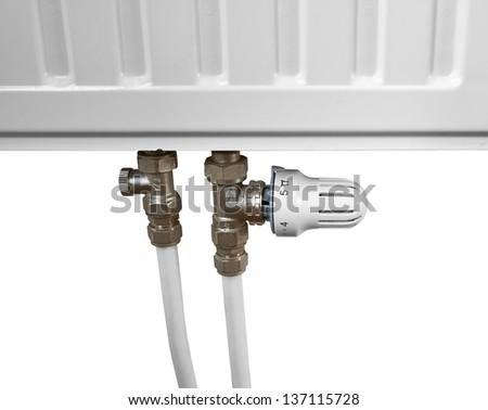 White radiator in an apartment. - stock photo