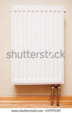 white radiator on the wall - stock photo