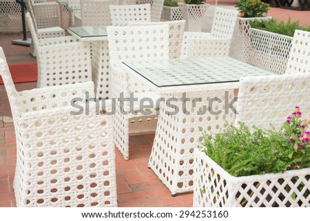 white rattan sofa and table sets in outdoor - stock photo