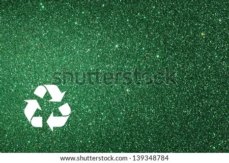 white recycle sign and green glitter lights background. defocused lights. - stock photo