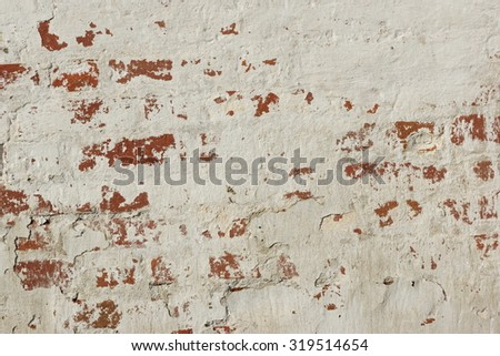 White Red Old Brick Painted Wall With Damaged Plaster Background Texture - stock photo