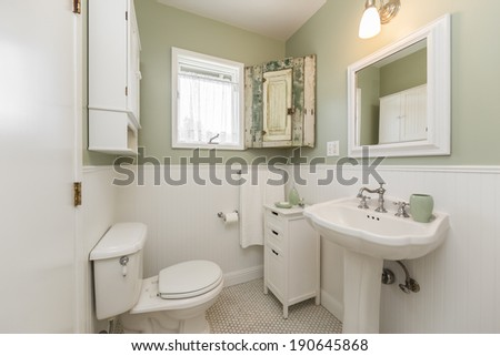 White remodeled bathroom with fitted counters and new shelf.  - stock photo