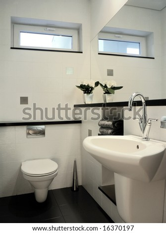 white restroom with big mirror - stock photo