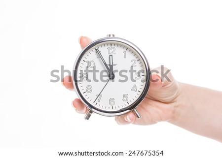 white retro alarm clock shows five minutes to twelve - stock photo