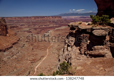White Rim Road in Canyonlands National Park from Island In the Sky Mesa - stock photo