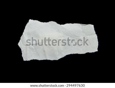white ripped pieces of paper on black - stock photo