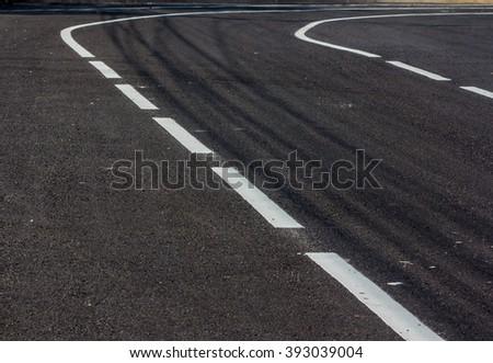 White road markings on asphalt - stock photo