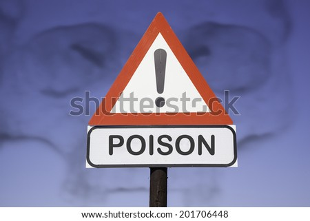 White road warning triangle with black  exclamation point and red frame on  a wooden mast in front of a blue sky with the shadow of a skull. A second rectangular sign warns in english about  poison - stock photo