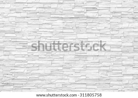 White rock stone brick tile wall aged texture detailed pattern background: Grunge ancient rustic limestone rock patterned backdrop for decoration   - stock photo