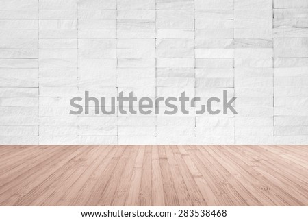 White rock tile wall with wooden floor in red brown color tone for interior background  - stock photo