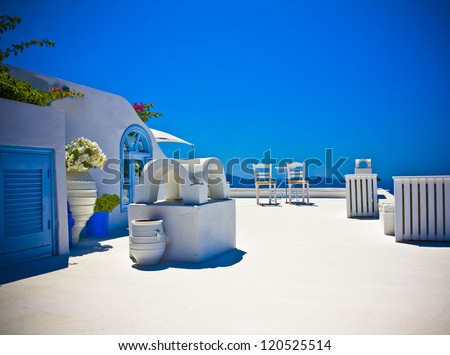 white roof of houses in Santorini with amazing seascape - stock photo