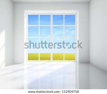 white room with a view of field from window - stock photo