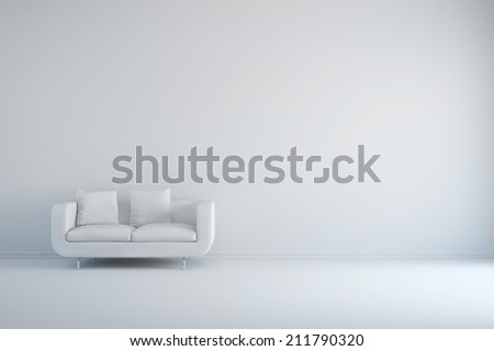 White room with sofa and empty background wall - stock photo