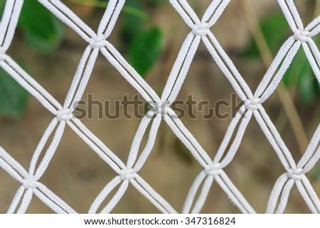 white rope net in nature - stock photo