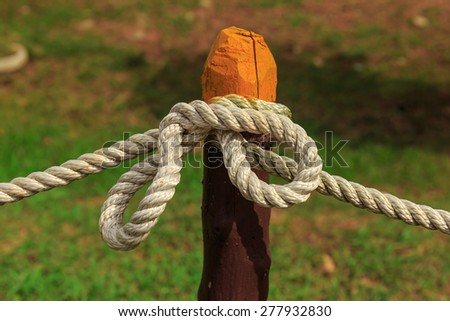 white rope tied on the color pole - stock photo