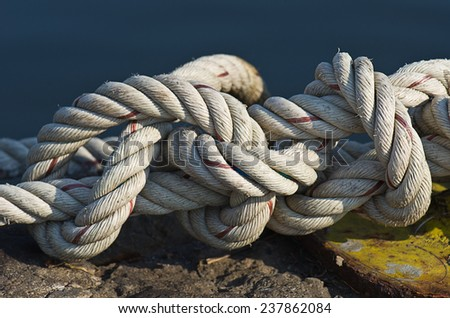 White rope tied spiral, strength - stock photo