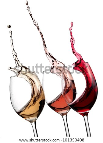 White, rose and red wine glasses up - stock photo