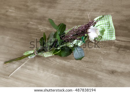 white rose lays on the wooden table top