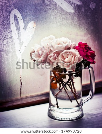 White roses in a glass vase with heart/ Valentines day romantic background - stock photo
