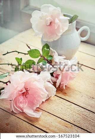 White roses in a vase in vintage style/ Valentines day background - stock photo