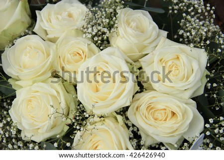 White roses, mixed with green in a bridal bouquet
