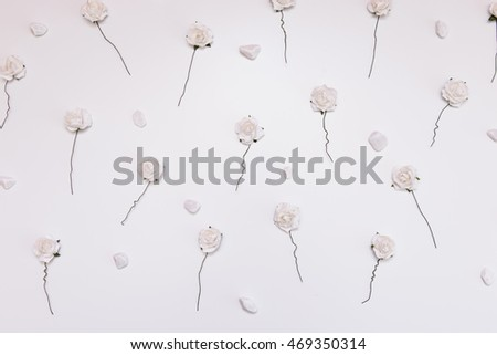 white roses with stones in creative conception
