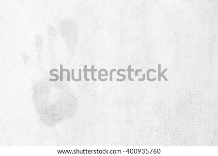 White rough cement floor dirty texture background. Surface dirty old building house gray tone. Empty partition weathered scratched. interior construction with aging dull. Palm prints on the wall. - stock photo