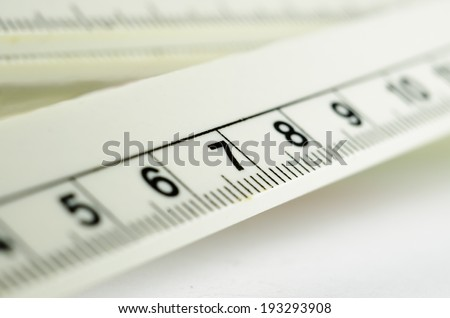 White ruler macro number seven - stock photo