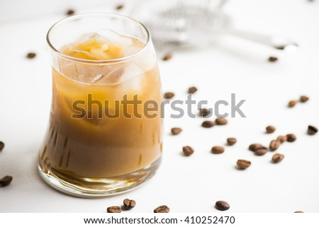 White russian cocktail on the white wooden background - stock photo