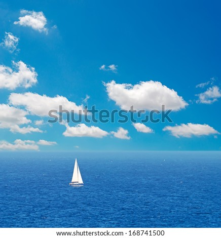 white sail alone in the sea - stock photo
