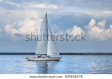 White sail yacht sailing in a calm sea. Riga, Latvia - stock photo