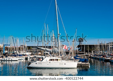 white sailing boat mooring at barcelona harbour - stock photo