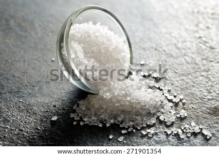 white salt on black kitchen table - stock photo